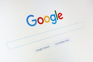 Google.com homepage and cursor on the screen. Google is world's most popular search engine