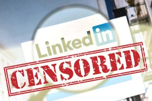 lilnkedin logo under magnifying glass with the word censored over