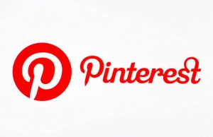 Pinterest logotype on pc screen.