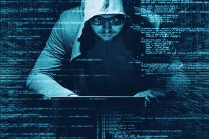 Hacker working on a code on dark digital background with digital interface around
