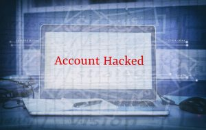 computer screen with wordaccount hacked