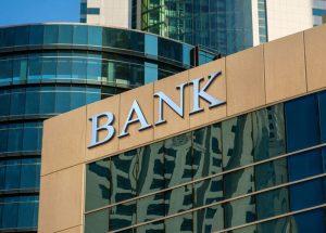 Bank sign on glass wall