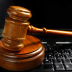 judges wooden gavel court gavel on a laptop computer (cyber law)