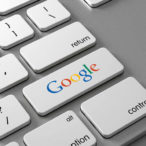 A keyboard with a button Google