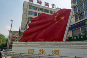 Chinese flag displayed in the street in Xining, China. Symbol of nationalism.