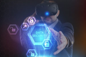 The concept of business, technology, the Internet and the network. A young entrepreneur working on a virtual screen of the future and sees the inscription Data security