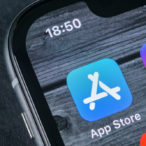 Apple store application icon on Apple iPhone X smartphone screen close-up.
