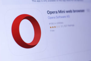 Opera Mini web browser app in play store. close-up on the laptop screen