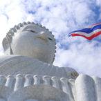 The flag of Thailand flies in front of the Phra Puttamingmokol Akenakkiri Buddha, known as the Big Buddha (1)