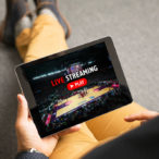 Man watching sports on live streaming online servic